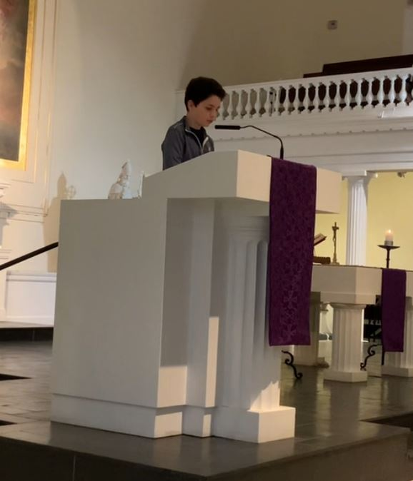 Student Reading at Sunday Mass
